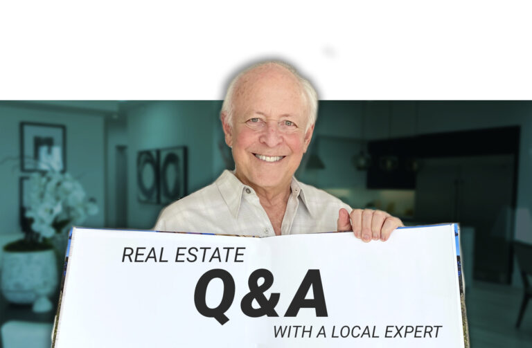 Michael Edlen holding Q&A sign