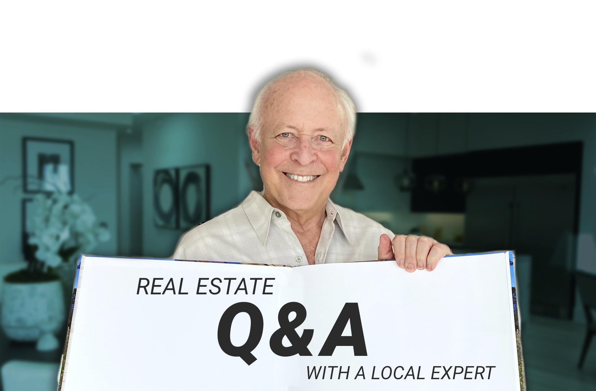 Michael Edlen holding Q&A sign