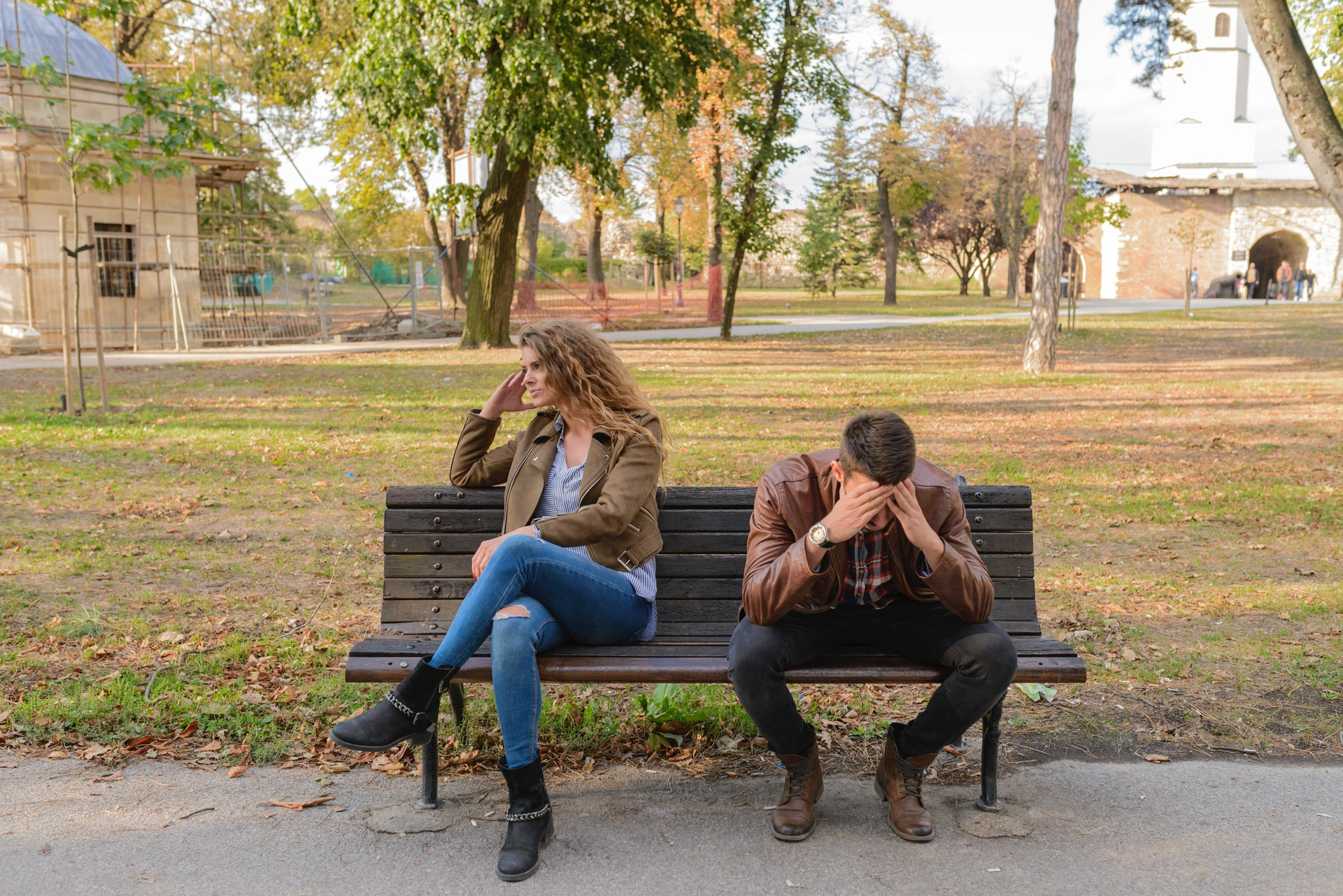 picture of distressed couple on park bench
