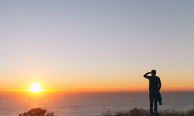This is a photo of a man looking off to the sunset. It is to illustrate Michael Edlen and the Edlen Team's perspective on the future of the real estate market in Pacific Palisades, California.
