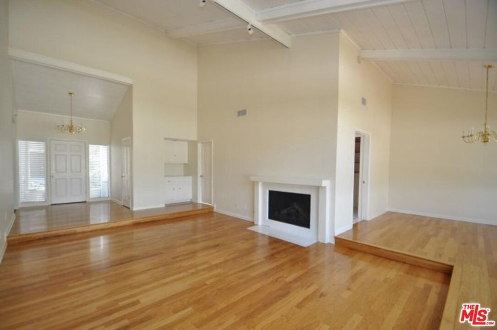 not furnished living room with hardwood floors