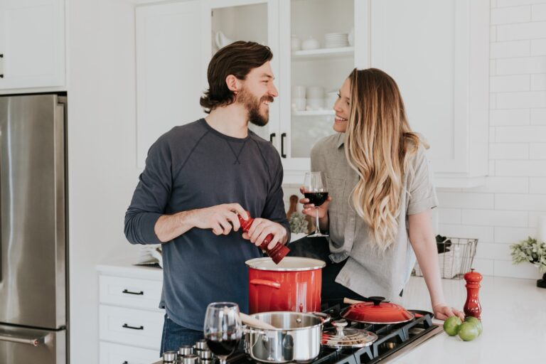 happy homeowners in kitchen smiling